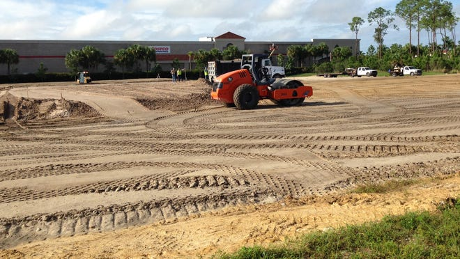 Earth-moving machinery prepares land for future stores at Gulf Coast Town Center in Estero.