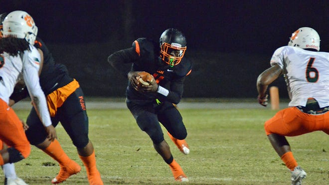 Bruce Judson carries the ball Friday night in Cocoa as the Tigers hosted Jones High School.