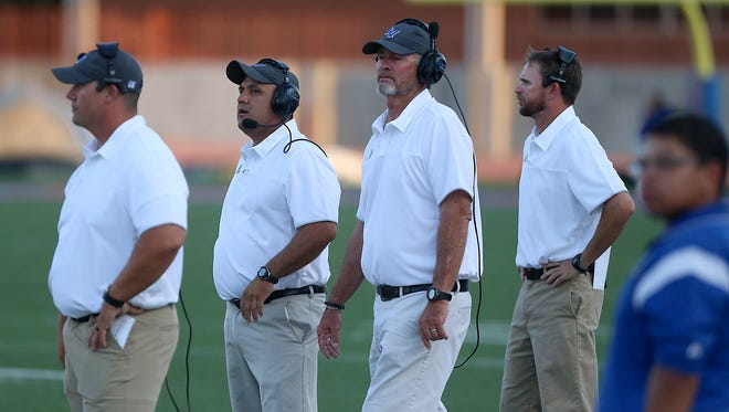 Lake View football coaches (from left to right) Ben Lyons, Hector Guevara, Gerald Butts and Chad Kinney watch the field during the first quarter of Friday's season-opening football game at San Angelo Stadium on Sept. 1, 2017. Lyons goes into his second year as defensive coordinator. Guevara starts his second year as head football coach while Kinney is also the head baseball coach.