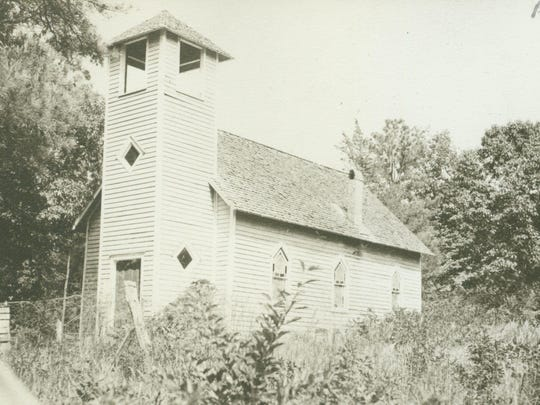 The church that is also on the site, which burned down and was replaced in 1959, is pictured here in 1930.