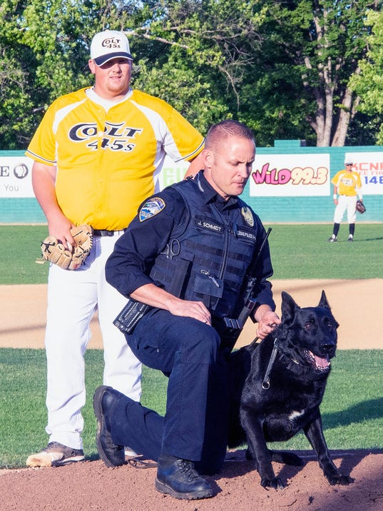 636643181192058750-RPD-K-9-officer-Jeff-Schmidt-gets-Abel-ready-for-first-pitch-as-starting-pitcher-James-Humphrey-looks-on.jpg