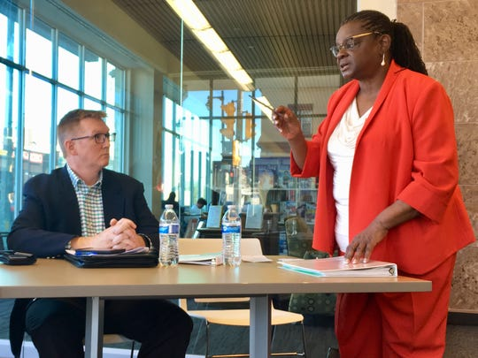 U.S. Rep. Gwen Moore (D-Wis.) speaks at a forum Saturday on the Mid-America Steel Drum plant. John Heneghan, director of field operations for U.S. Department of Transportation's Pipeline and Hazardous Materials Safety Administration listens.