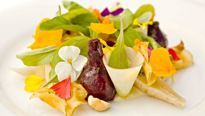 Detail of the beet and sunchoke and edible flower salad from Quiessence, at the Farm at South Mountain.