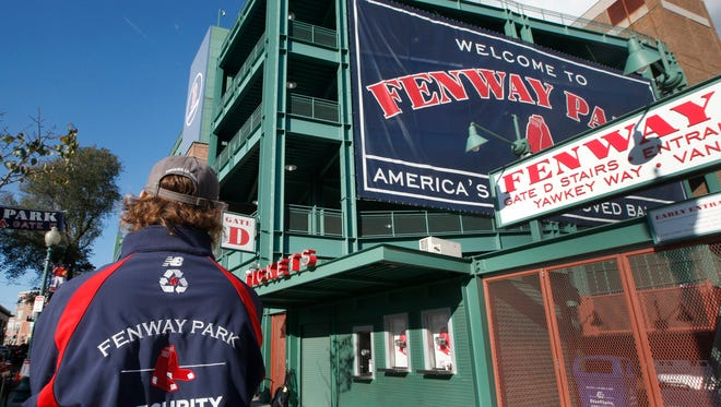 A security guard keeps an eye on things outside Gate D at Fenway Park in Boston, Tuesday, Oct. 29, 2013.