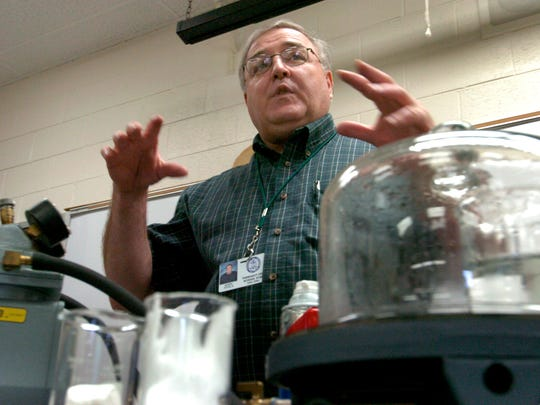 John Ayala, a chemistry teacher at Farragut High School, entered the teaching world after working in the business world. Knox County Schools is trying to entice more career professionals into the classroom -- at least temporarily -- through a new partnership called the Distinguished Professionals Education Institute. The institute is trying to recruit professionals to teach hard-to-staff courses in the science, math and foreign language fields. Ayala explains an experiment he is about to performs for  his students.