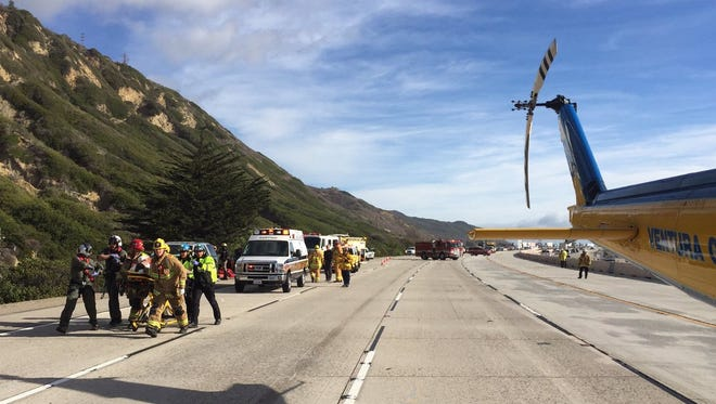 A patient in an accident Monday afternoon on northbound Highway 101 near La Conchita is taken to a helicopter to be transported to Ventura County Medical Center.