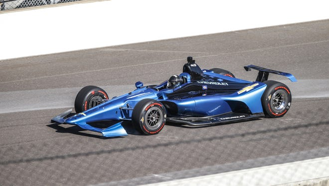 Juan Pablo Montoya drives the new IndyCar during testing for the 2018 Verizon IndyCar Series Aero Kit at Indianapolis Motor Speedway on Tuesday, July 25, 2017.