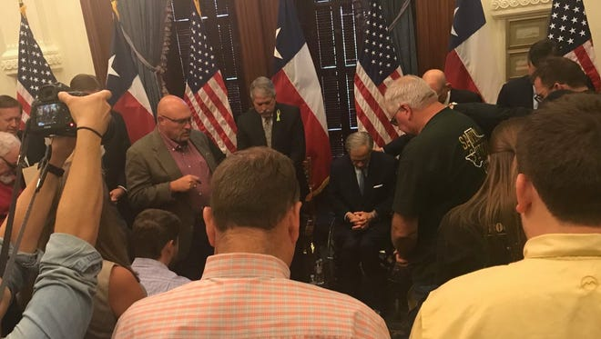 Frank Pomeroy, pastor of the First Baptist Church of Sutherland Springs, leads a prayer after Gov. Greg Abbott's third round-table on gun violence, May 24, 2018