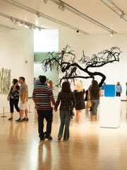 Guests take in the artwork at the Phoenix Art Museum