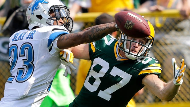 Detroit Lions' Darius Slay defends a pass to Green Bay Packers' Jordy Nelson in the end zone. The Green Bay Packers host the Detroit Lions during on Sunday, September 25, 2016, at Lambeau Field in Green Bay, Wis.