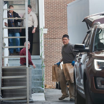 Several county detectives were seen entering the building