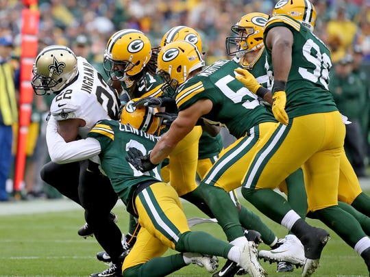 Green Bay Packers free safety Ha Ha Clinton-Dix (21) and the rest of the defense converge on running back Mark Ingram (22) against the New Orleans Saints Sunday, October 22, 2017 at Lambeau Field in Green Bay, Wis.