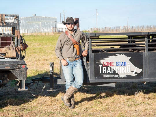 Reporter-News file photo: Wyatt Walton has turned trapping feral hogs into a good business.