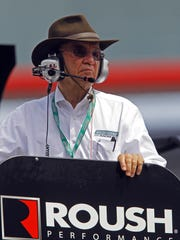 Team owner Jack Roush watches from a car hauler during