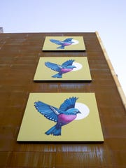 """Three Birds"" by Lauren Lee on the iLuminate building"
