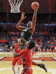 Michigan State's Nick Ward shoots the ball over Illinois'