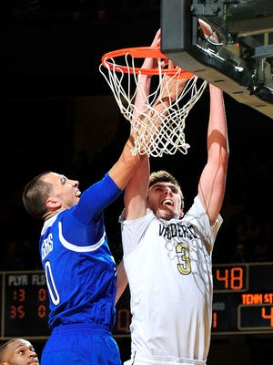 Vanderbilt forward Luke Kornet, right, is fouled by Tennessee State forward Zachary Lee during the first half Sunday.