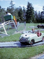 A photo of kids riding in the cars at Willow Point Park.