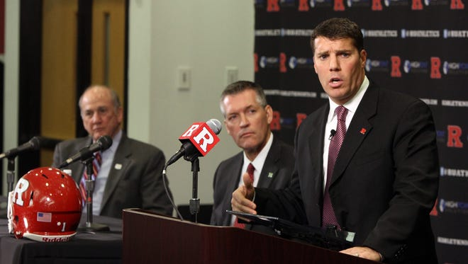 Chris Ash (podium) spoke about recruiting New Jersey during a press conference introducing him as the new Rutgers football coach on Monday.