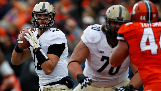 Purdue quarterback Austin Appleby (12) sets up for a throw against Illinois during the first half of an NCAA college football game on Saturday, Oct. 4, 2014, in Champaign, Ill. (AP Photo/Andrew A. Nelles)