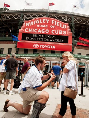 Steve Bell proposed to Katie Inabnit at Wrigley Field. The two are set to get married in July.