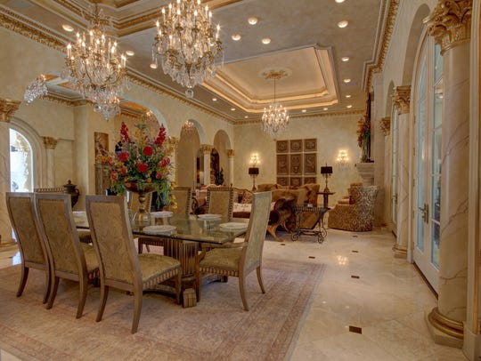 Formal dining fit for a king with and 9 crystal chandeliers