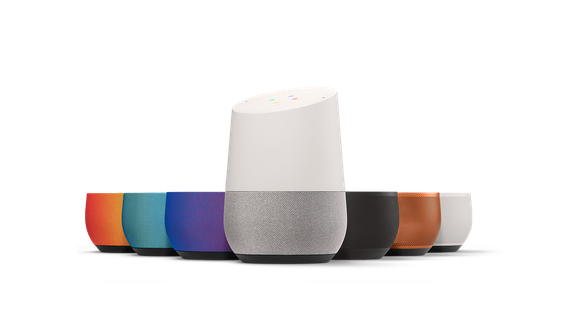 Google Home smart speaker, along with its interchangeable bases of different colors