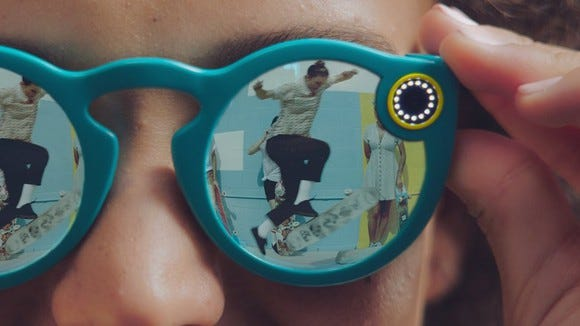 Someone wearing Snapchat's Spectacles.