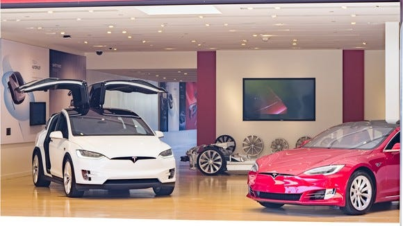 Model X (left) and Model S (right) in a Tesla store.