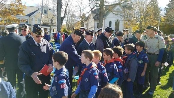 Veterans met with scouts during the 2016 Veterans Day observances in Westford. Veterans number among those seeing great needs, as the coronavirus forces isolation that puts vulnerable groups out of sight.
