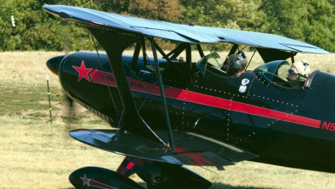 Pilot Rod Tarter in the back and an unidentified passenger in the Starduster Too, made in 1972. Tarter died weeks after the plane crashed in September 2007. The cause of the crash is still unresolved.