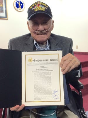 Andrew Kim holds his proclamation given to him by Sen., Steve Daines for being one of the two first Montanans to participate in the Veterans History Project.