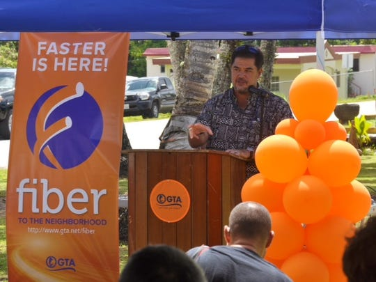 "Andrew Gayle, GTA chief operating officer, speaks at the company's rollout of ""Fiber to the Neighborhood"" outside the Yigo mayor's office on May 7, 2015"