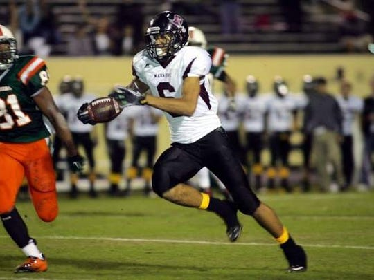 Jordan Leggett bursts up the field for a run-after-catch during his senior season at Navarre in 2013.