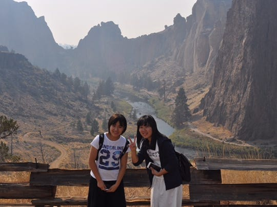 Ami Sato, left, and Satsuki Yoshikawa, students from Kawagoe, Japan, pose at Smith Rock State Park during their stay with Bob and Cheryl Wells in 2015. Every other year, 22 middle school students from Kawagoe visit Salem.