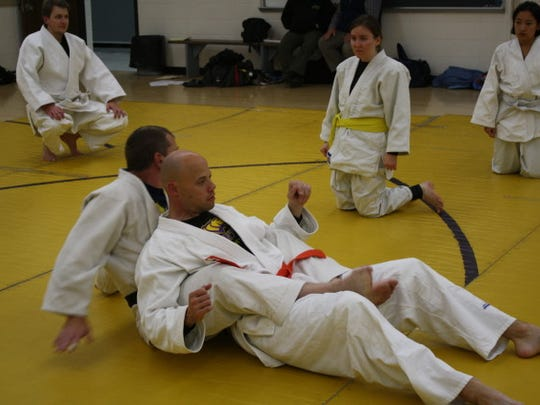 Sensei Wanta is demonstrating technique on Dr. Tim Wright.