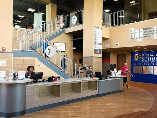 Members circulate through the new lobby of the Greater Naples YMCA's Healthy Living Campus on Sunday, Sept. 6, 2015 in North Naples. Two years after a fire caused by lightning heavily damaged the YMCA, the organization has rebuilt its fitness facilities and is looking towards the next phases of construction, including a new pediatric clinic and child care facility.