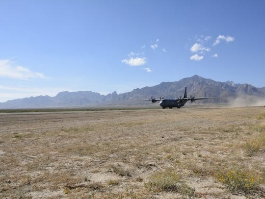 A C-130 transport plane takes off from Condron Army