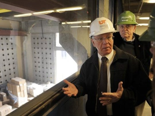 Wayne T. Davis, center, dean of the college of engineering at the University of Tennessee, gives a tour of the new John Tickle building on Neyland Drive in February 2013. Davis and architect Duane Grieve stand at a window overlooking the two-story beam testing lab built on the first floor.