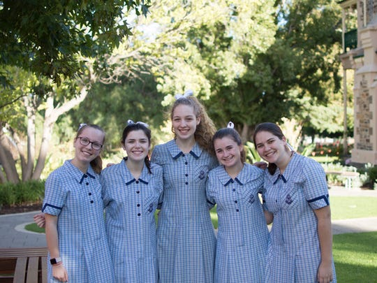 Left to right: Kent Place sophomores Sophie Schmitz, Clare Buckley, Lane Patterson, Lizzie Herr, and Sofia Handzy in the St. Peter's uniforms.