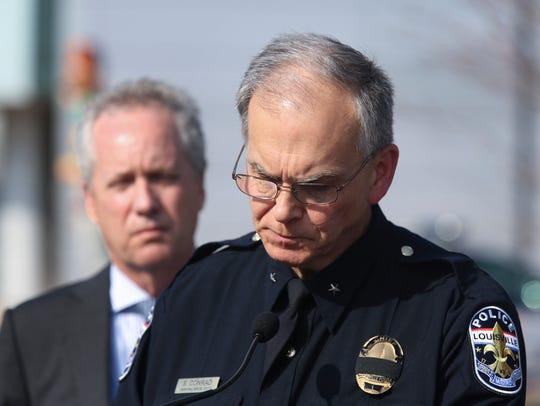 Louisville Metro Police Chief Steve Conrad, right,