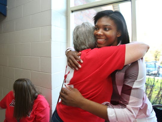 Myisha Hines-Allen, right, hugged Cardinal fan Sue Knabel during a WNBA draft watch party for the Louisville senior at the Berrytown Recreation Center.    Apr. 12, 2018