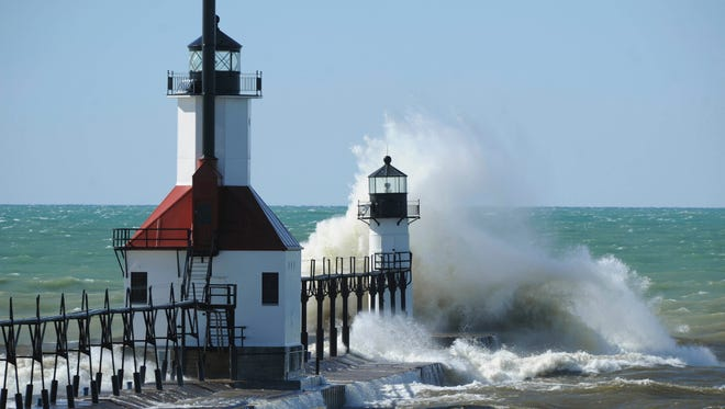 Waves crash into the St. Joseph Lighthouses in March 2017 in St. Joseph, Mich.