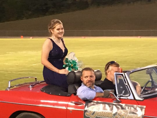 Freshman Attendant Danni Ryan rides in a classic MG convertible during 2017 Homecoming activities at Houston County High School.