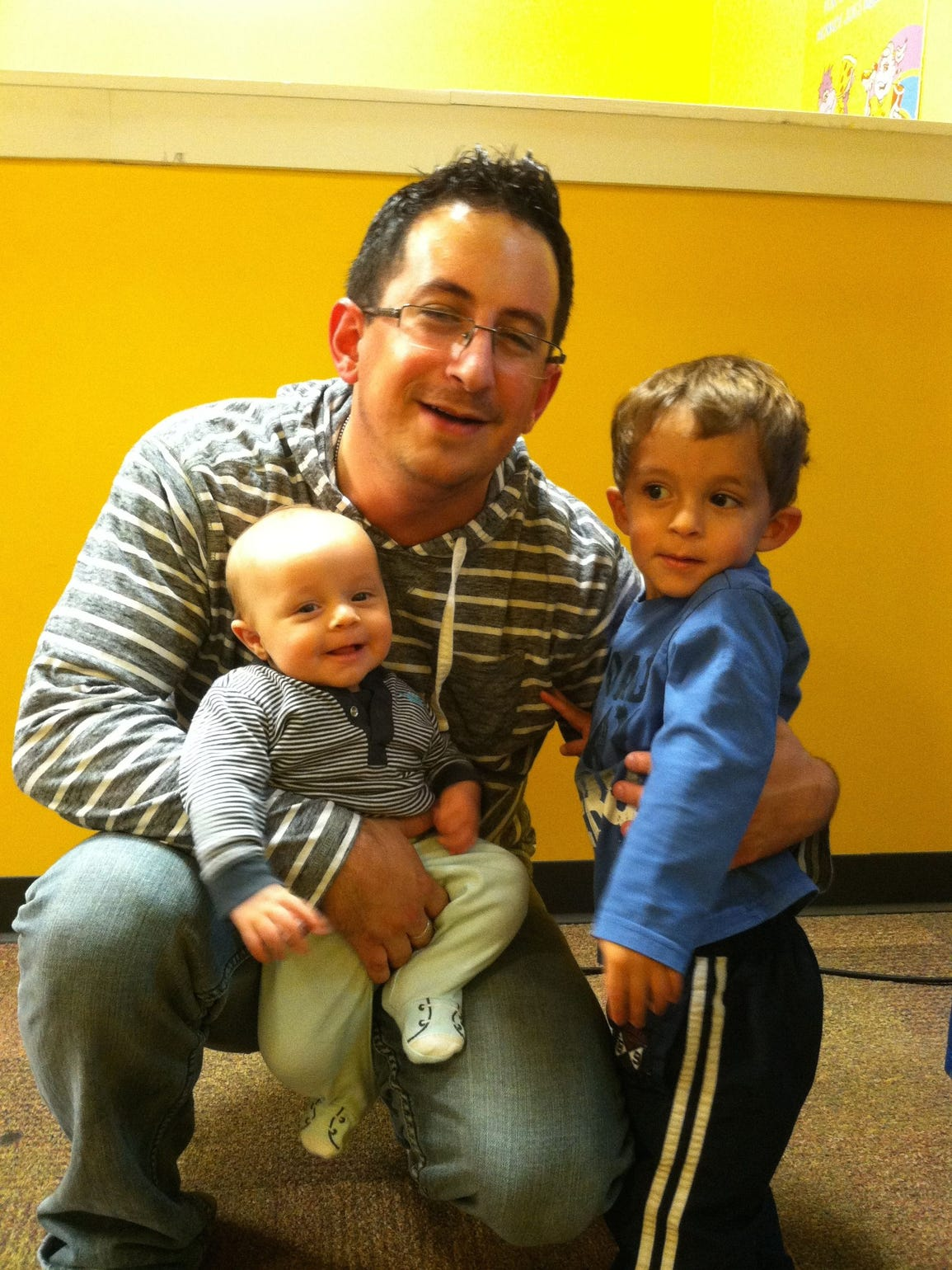 Chris Snyder with his two sons before deployment to