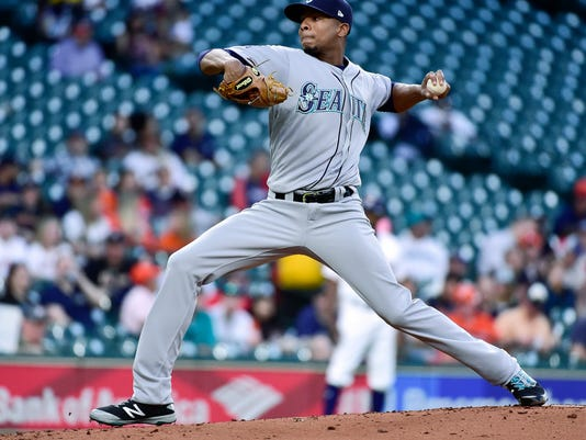 Seattle Mariners starting pitcher Ariel Miranda delivers during the first inning of the team's baseball game against the Houston Astros, Thursday, April 6, 2017, in Houston. (AP Photo/Eric Christian Smith)