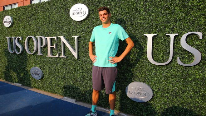 Taylor Harry Fritz poses at the 2015 U.S. Open. He won his first match as a pro this year.