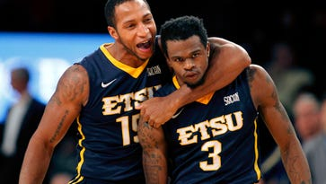 East Tennessee State Buccaneers forward Lester Wilson (15) and guard Ge'Lawn Guyn (3) show emotion against the Georgia Tech Yellow Jackets in the second half at McCamish Pavilion. East Tennessee State defeated Georgia Tech 69-68.