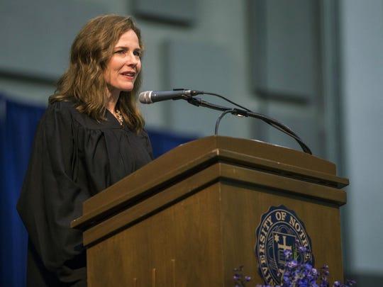 FILE - In this May 19, 2018 file photo, Amy Coney Barrett, United States Court of Appeals for the Seventh Circuit judge, speaks during the University of Notre Dame's Law School commencement ceremony at the University of Notre Dame in South Bend, Ind. Barrett is one of four judges thought to be President Donald Trump's top contenders to fill a vacancy on the Supreme Court. (Robert Franklin /South Bend Tribune via AP, File)