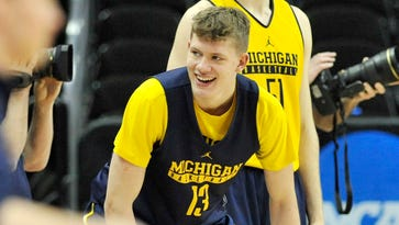 Michigan forward Moritz Wagner (13) gets ready for the three-man weave drill during the Michigan workout Wednesday in Kansas City.
